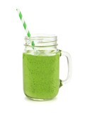 Healthy green smoothie with straw in a jar mug isolated