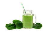 Healthy green smoothie with spinach in a jar mug isolated