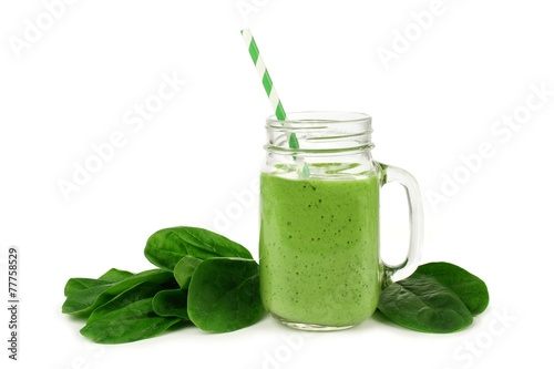 Healthy green smoothie with spinach in a jar mug isolated - 77758529