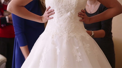 bride wears a wedding dress