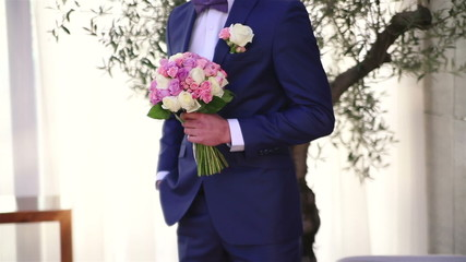 groom and wedding bouquet