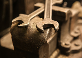 old metal vice and wrenches