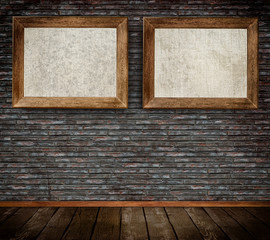 Old wooden frames on bricks wall.