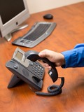 close up shot of a person disconnecting landline phone poster