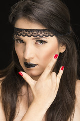young gothic beautiful woman with red nails