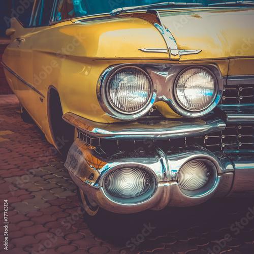Old retro or vintage car front side. Vintage effect processing Poster