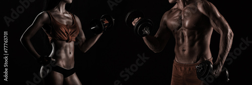 Bodybuilding. Strong man and a woman posing on a black backgroun - 77763701