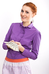 Young girl with hundred dollar bills in her hands