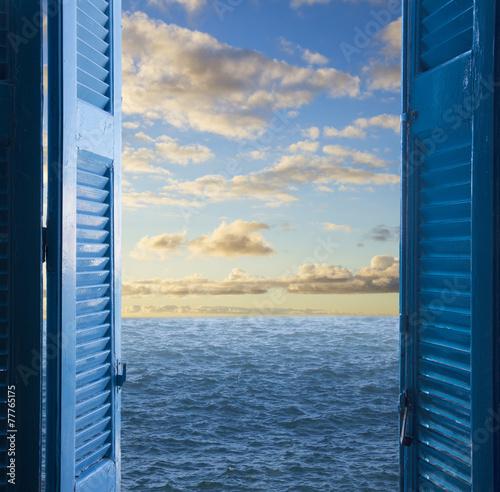 Fototapeta room with open door to seascape