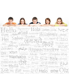 Group of teenagers on a background of many words