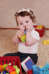 Ten months baby girl playing with toys