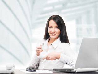 Young and attractive business woman working in office isolated o