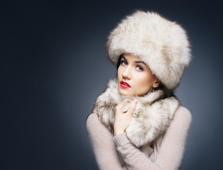 Portrait of a young and beautiful lady in a winter clothes