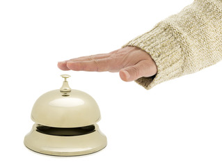 of a man ringing hotel bell isolated on white