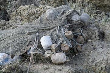 Fishing net lying on the shore