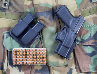 Military weapon and bullets with Uniform