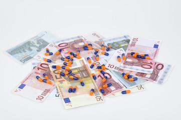 euro banknotes and pills