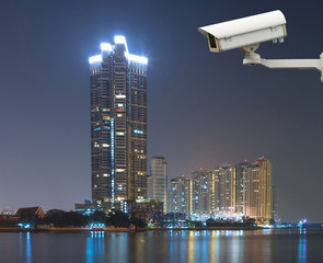 Security camera monitoring the cityscape river view at twilight
