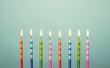 Leinwandbild Motiv Colorful birthday cake candles