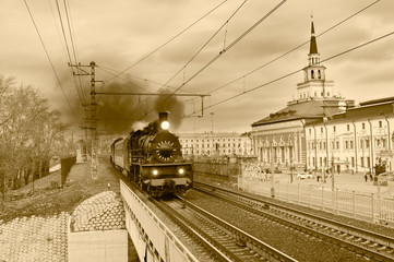 Steam retro train goes in the center of Moscow.
