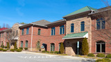 Red brick commercial buildings row with office space