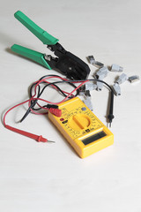 multimeter tester, press pliers and RJ45 connectors