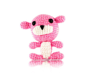 handmade crochet pink tiger doll on white background