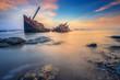 Leinwanddruck Bild - Broken ship with the sunset