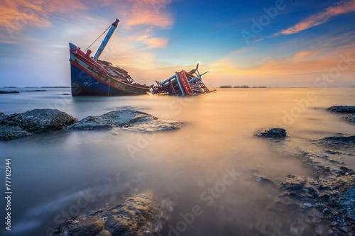 Leinwanddruck Bild Broken ship with the sunset