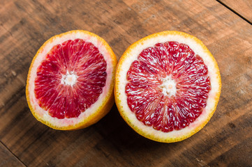Blood orange halves on table