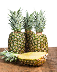 Fresh pineapples with a half