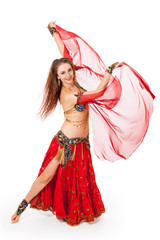 Young belly dancer in motion