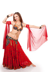 Young belly dancer in dance pose
