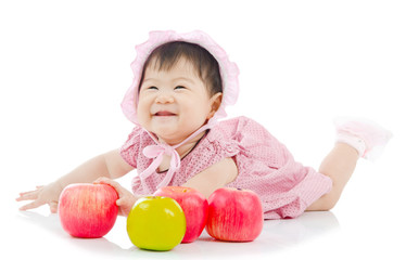 Cute asian baby girl with apples
