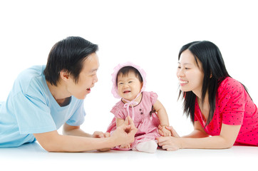 Asian parent playing with their 6 months old baby girl