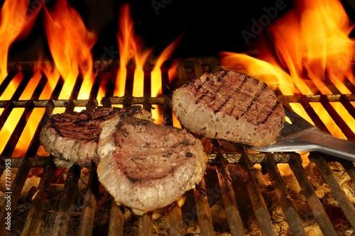 Fototapeta Beefsteaks on the Flaming Grill