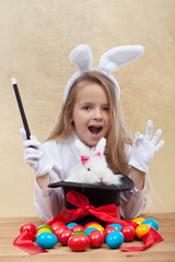 Little magician girl conjuring easter items