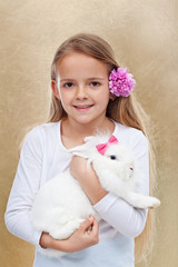 Cute little girl with her rabbit