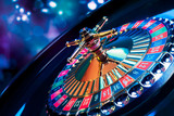 Fototapety Roulette wheel with a bright and colorful background