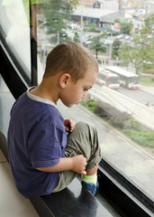 Child looking from window