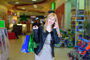 Girl shopping and talking on the phone