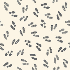 Seamless background with human footprints