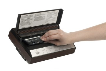 hand inserting cassette in an answering machine