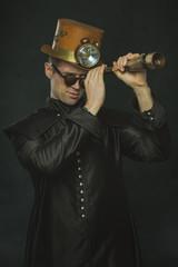Steampunk man in a long coat looking through a telescope.