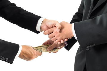 Buisnessmen shaking hands and receiving banknote
