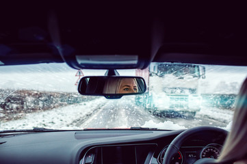 woman driving snowing