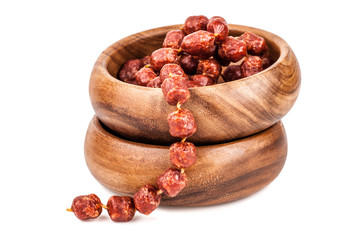 mini salami in a wooden bowl isolated on white background