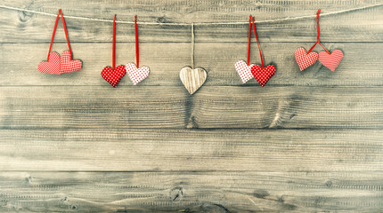 Red hearts on wooden background. Valentines Day. Retro style