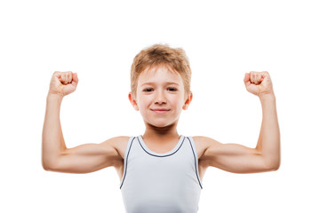 Smiling sport child boy showing his hand biceps muscles strength