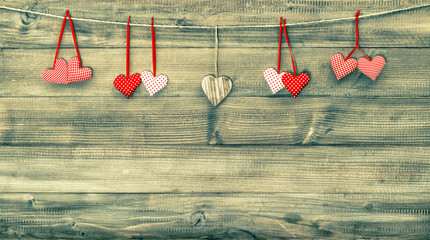 Red hearts on wooden background. Valentines Day. Vintage style